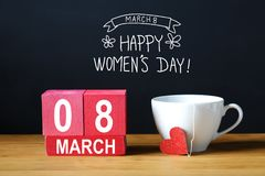 Womens Day message with coffee cup. With wooden blocks Stock Image