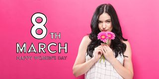 Womens Day message with young woman with garbela. Flowers royalty free stock image