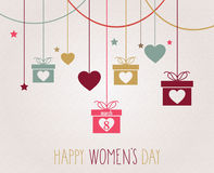 Womens Day poster. Hanging colorful gift Royalty Free Stock Photos