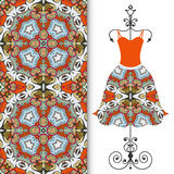 Womens dress on a hanger and seamless geometric pattern Royalty Free Stock Image