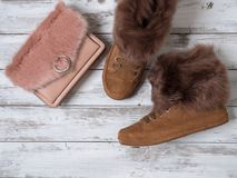 Womens fashion accessories, shoes suede sneakers, crossbody bag. Shopping concept. Flat lay. Winter collection royalty free stock image