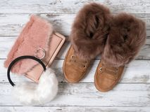 Womens fashion accessories, shoes suede sneakers, crossbody bag, white fur earmuffs. Shopping concept. Flat lay. Winter. Collection royalty free stock photos