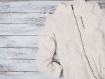 Womens fashion clothes plush jacket. Shopping concept. Flat lay. Winter collection royalty free stock photo