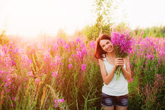 Womens in flowers. Royalty Free Stock Images