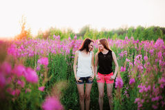 Womens in flowers. Royalty Free Stock Image