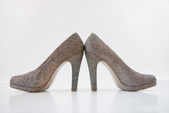 Womens golden high heels Royalty Free Stock Photography