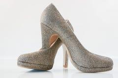 Womens golden high heels Stock Images
