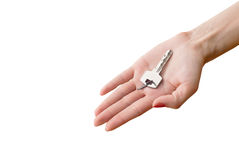 Womens hand giving key from house Stock Photography