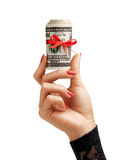 Womens Hand holding Money with red ribbon Stock Images