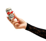 Womens Hand holding Money with red ribbon Royalty Free Stock Images