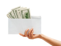 Womens Hand passes the envelope with dollars. Royalty Free Stock Photography