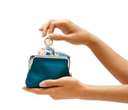 Womens Hand Throwing A Coin One Euro In The Full Purse Stock Images