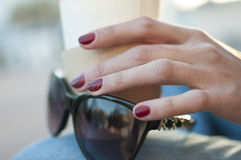 Womens hand whits cup and glasses Stock Images
