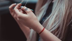 Womens hands with Arrows on the fingers, red line on the wrist - tattoos. Hipster style royalty free stock photos