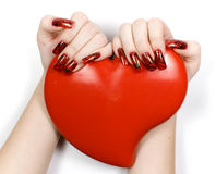 Womens hands with heart. And decorate manicure Royalty Free Stock Photo