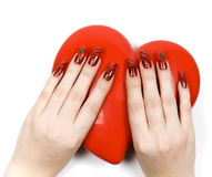 Womens hands with heart. And decorate manicure Stock Image