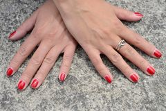 Womens hands with a manicure Stock Photos