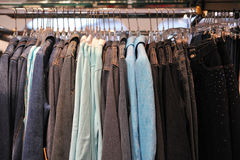 Womens jackets hanging on rail. Womens jackets hanging from rail in boutique Royalty Free Stock Photos