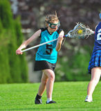 Womens Lacrosse face off. High School Girls lacrosse player ready for face off Royalty Free Stock Photos