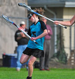 Womens Lacrosse Player 3. High School Girls lacrosse player lost the ball after being checked Royalty Free Stock Photo