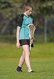 Womens Lacrosse Player. High School Girls lacrosse player walking the filed before the game Royalty Free Stock Photo