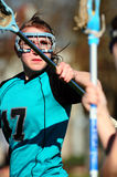 Womens Lacrosse Player blocking Royalty Free Stock Images