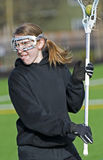 Womens Lacrosse Player Close up. Close up of a 17 yo High School Girls lacrosse player taking a shot at goal durring practice Royalty Free Stock Image