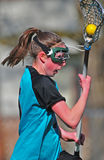 Womens Lacrosse Player running 01. Close up High School Girls lacrosse player running down the field with posession of the ball Stock Photo