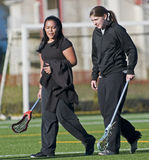 Womens Lacrosse Players heading to practice. Close up of a 17-18 yo High School Girls lacrosse players walking across the field to practice Royalty Free Stock Photo