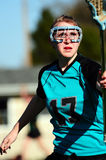 Womens LAX defender. High School Girls lacrosse player blocking her opponent Royalty Free Stock Photo