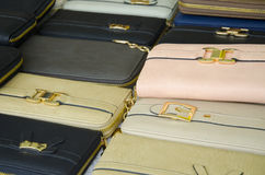Womens leather purses. New leather purses in assorted colors on display at a market royalty free stock photos