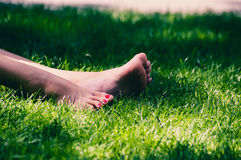 Womens legs on grass Royalty Free Stock Image
