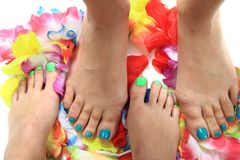 Womens legs with nice nails (pedicure) Stock Photography