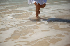 Womens legs in the sea water Royalty Free Stock Image