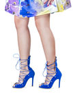 Womens legs in shoes Stock Images