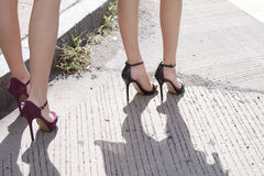 Womens legs showing her high heel shoes Royalty Free Stock Photos