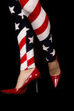 Womens legs wearing flag leggings and red high heels Stock Photo