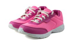 Womens pink sneakers with white laces isolated on white background. Royalty Free Stock Images