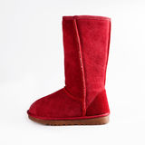Womens red Sheepskin boots  on white Stock Images