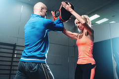 Womens self-defense workout with personal trainer Stock Image