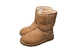 Womens sheepskin boots isolated on white Royalty Free Stock Photography