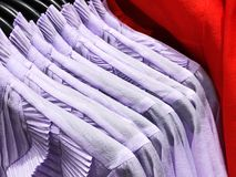 Womens shirts on the hanger in the store. Stock Photo