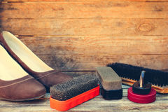 Womens shoes and care products for footwear Stock Photos