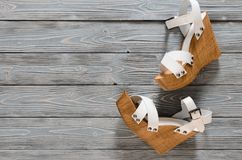 Womens shoes crisscross wood platform wedges on grey wooden ba. Ckground. Spring summer collection with copy space. Flat lay. Fashion concept. Template for royalty free stock photos
