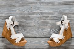 Womens shoes crisscross wood platform wedges on grey wooden ba. Ckground. Spring summer collection with copy space. Flat lay. Fashion concept. Template for royalty free stock image