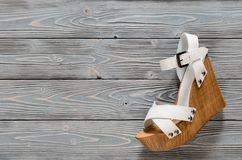 Womens shoes crisscross wood platform wedges on grey wooden ba. Ckground. Spring summer collection with copy space. Flat lay. Fashion concept. Template for stock photo
