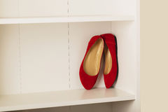 Womens shoes flats on the shelf in the closet. Selective focus royalty free stock photography