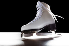 Womens shoes for ice-skate. Shiny blade and dynamically flowing shoelace Stock Photo