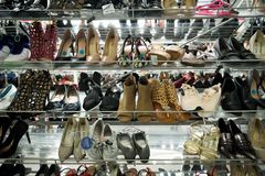 Womens Shoes on a rack royalty free stock photography