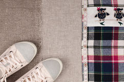 Womens sneakers and plaid shirt with lace insertion. Trendy lace Royalty Free Stock Photography